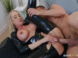 Refulgent latex catsuit on a hot mommy pulling fat cock