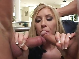 Brit Michelle blows two monster dicks