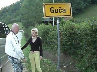 Two Serbian body of men hitchhiking