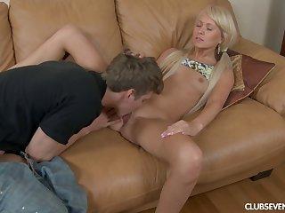 Close concerning pellicle of skinny blonde Vikki B having sex on the sofa
