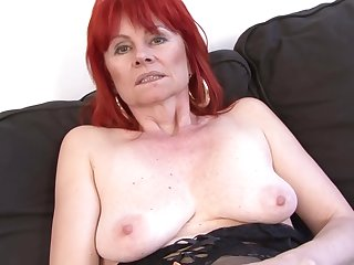 Red haired granny in erotic lingerie is having casual sexual congress with a black guy, on the sofa