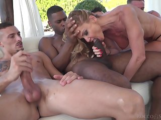 MILF sucks a federate of dicks before trying them all