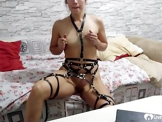 Anacreontic stepdaughter teases in a kinky belt gear