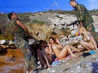 Amazing outdoors group sex on the beach with two sexy models