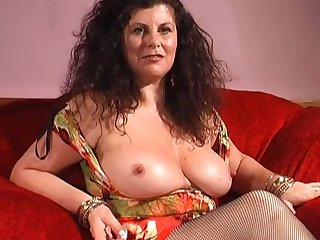 Provocative mature Gilly Simpson enjoys playing with sex toys